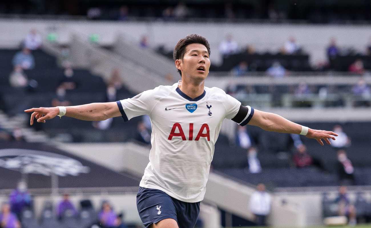 Tottenham player Son Heung-Min celebrates scoring a goal against Arsenal.