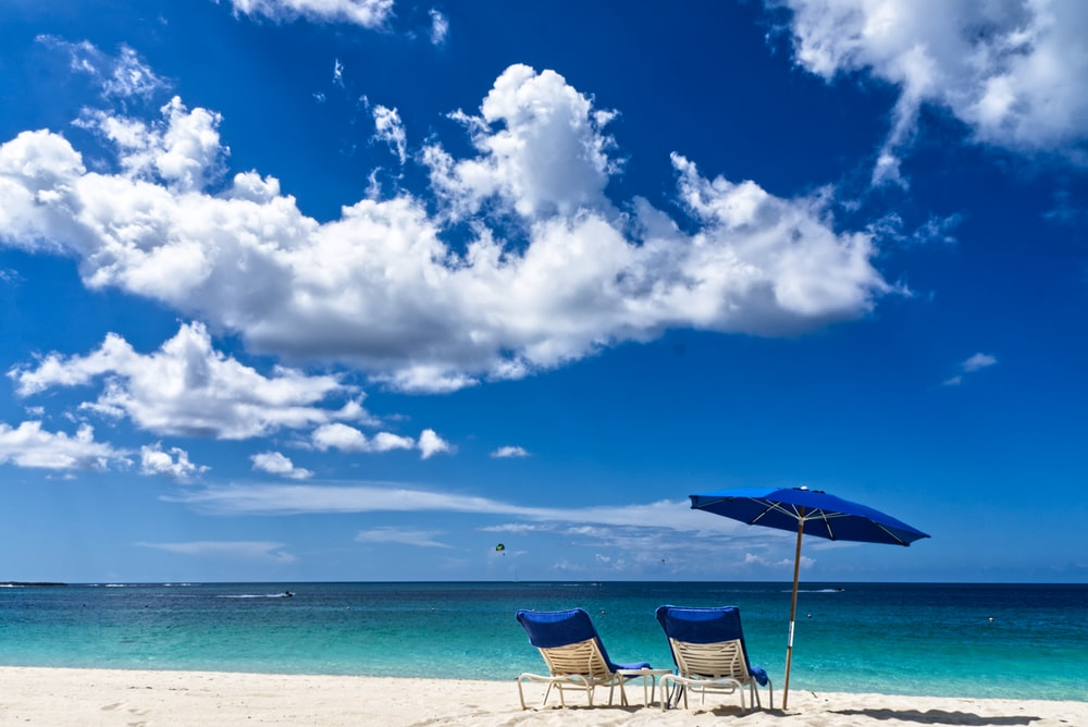 loungers and umbrella on beach
