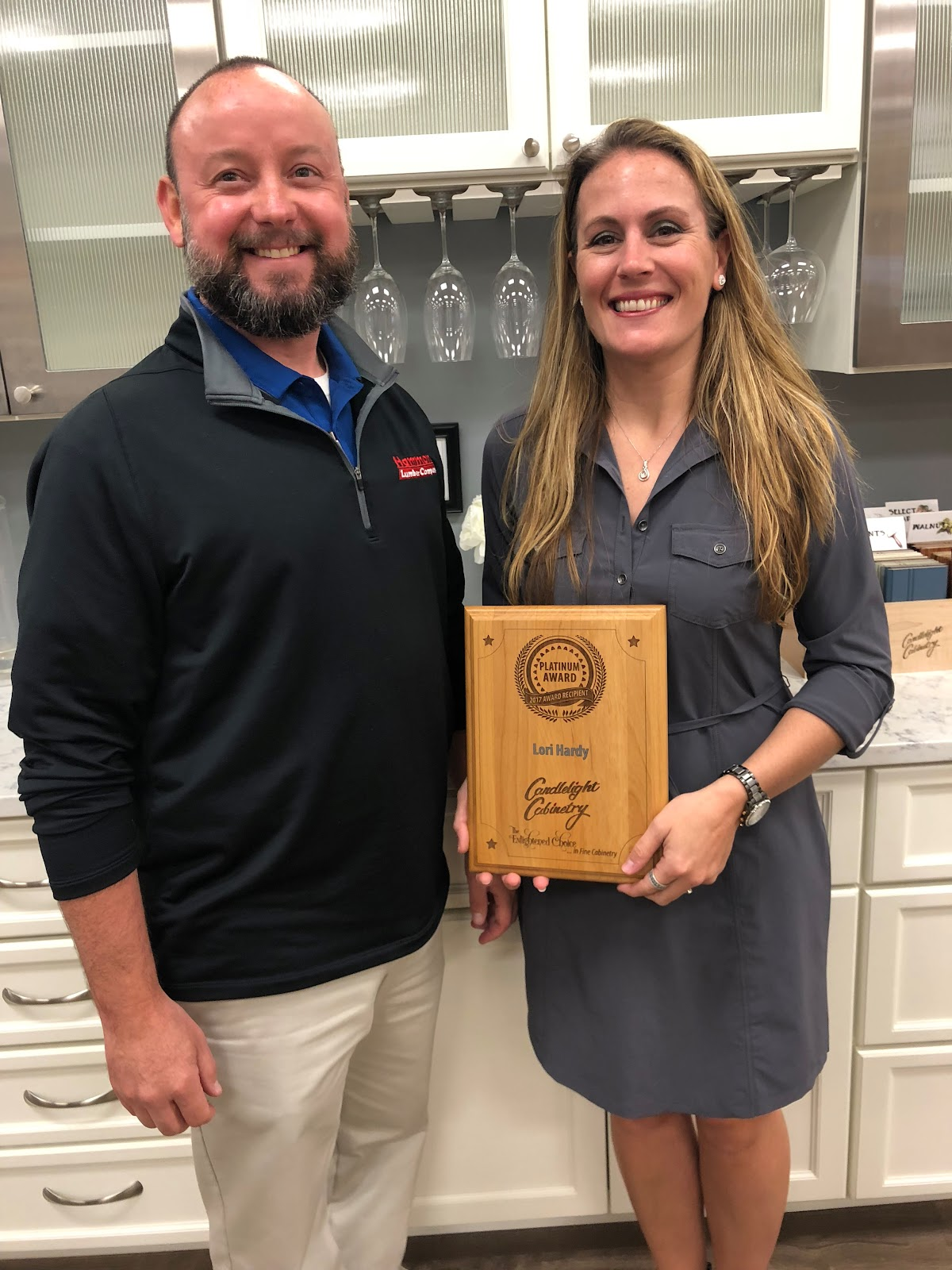 Lori Hardy & Steve Hardy with Loris platinum award from Candlelight Cabinetry
