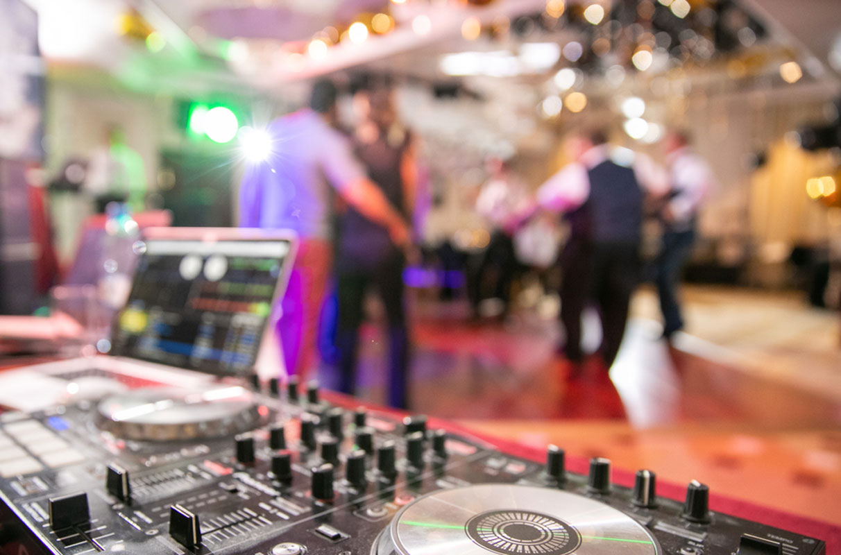 Wedding DJ booth during the dance party