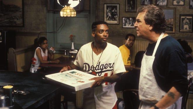 Race and class tensions smolder in Spike Lee's 'Do the Right Thing.'  In a scene from the 1989 motion picture Danny Aiello as Salvatore 'Sal' Fragione, right, plays to Spike Lee as Mookie.