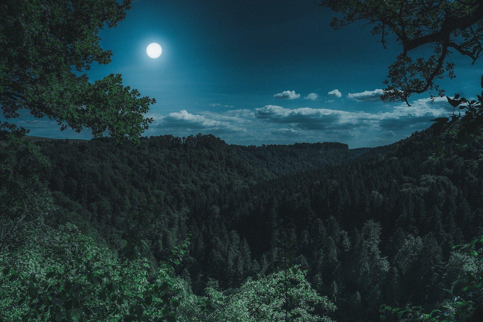 mountain range with view of the moon