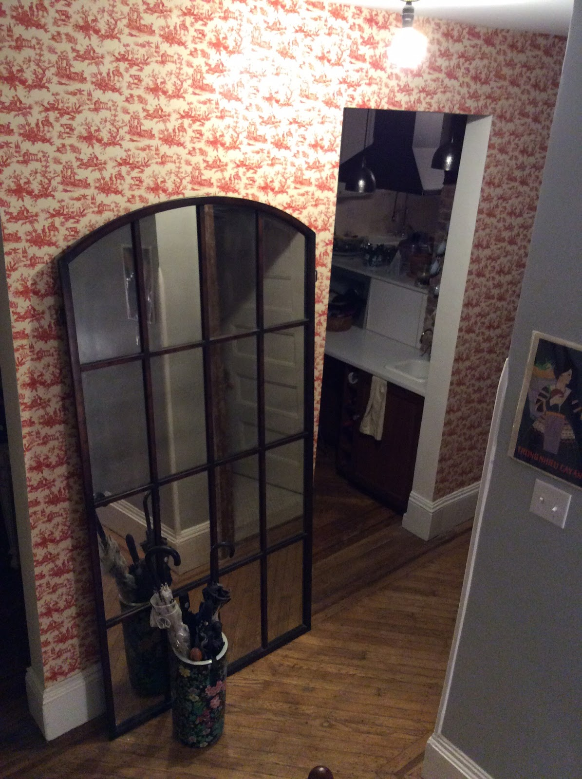 Foyer with large glass mirror and seat and umbrella stand