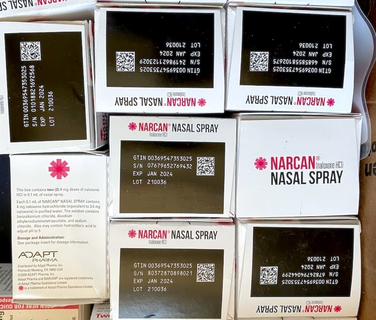 """Eight small red and black boxes labeled: """"NARCAN (naloxone HCI) nasal spray"""""""