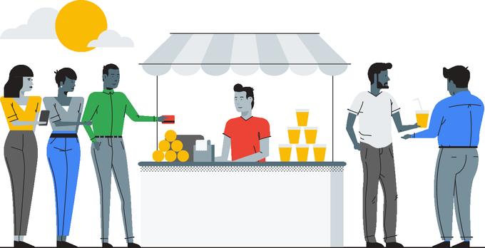 Man standing at profitable lemonade stand