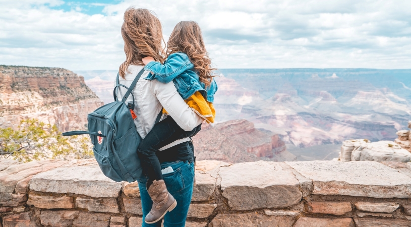 mother and daughter looking at the Grand Canyon