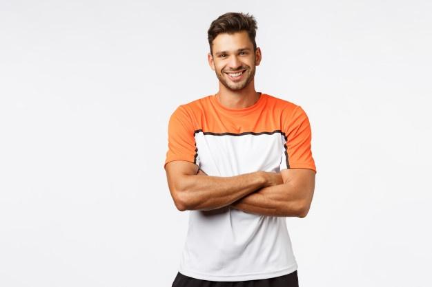 Handsome smiling man bodybuilder, cross arms over chest, wear sport t-shirt.