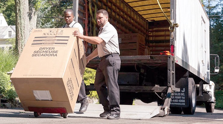 Picture: Workers unload delivery vehicle.