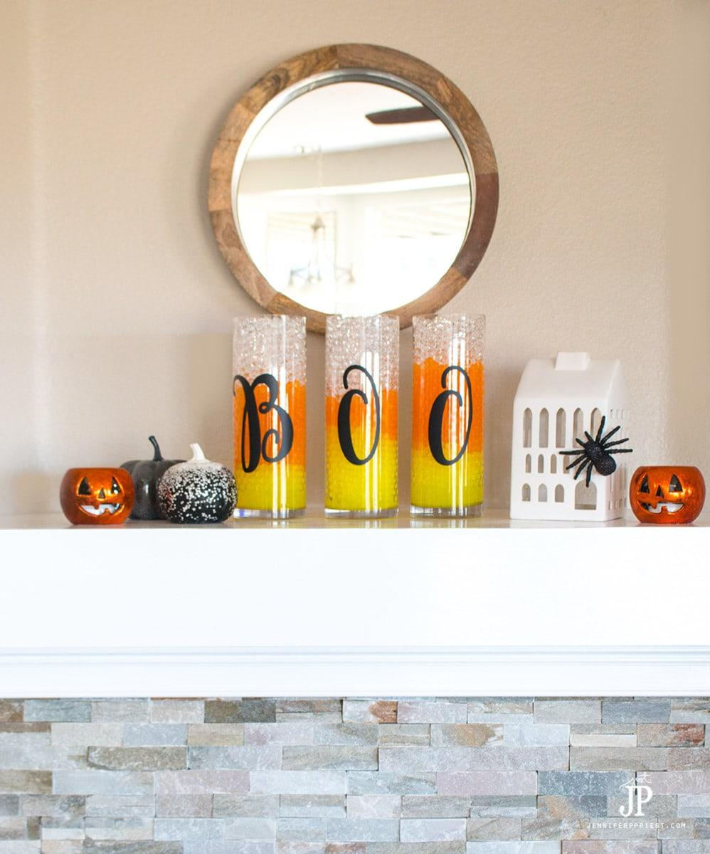 https://www.redfin.com/blog/wp-content/uploads/2020/10/BOO-Diy-Candy-Corn-Vases-SMART-FUN-DIY-jenniferppriest.jpg