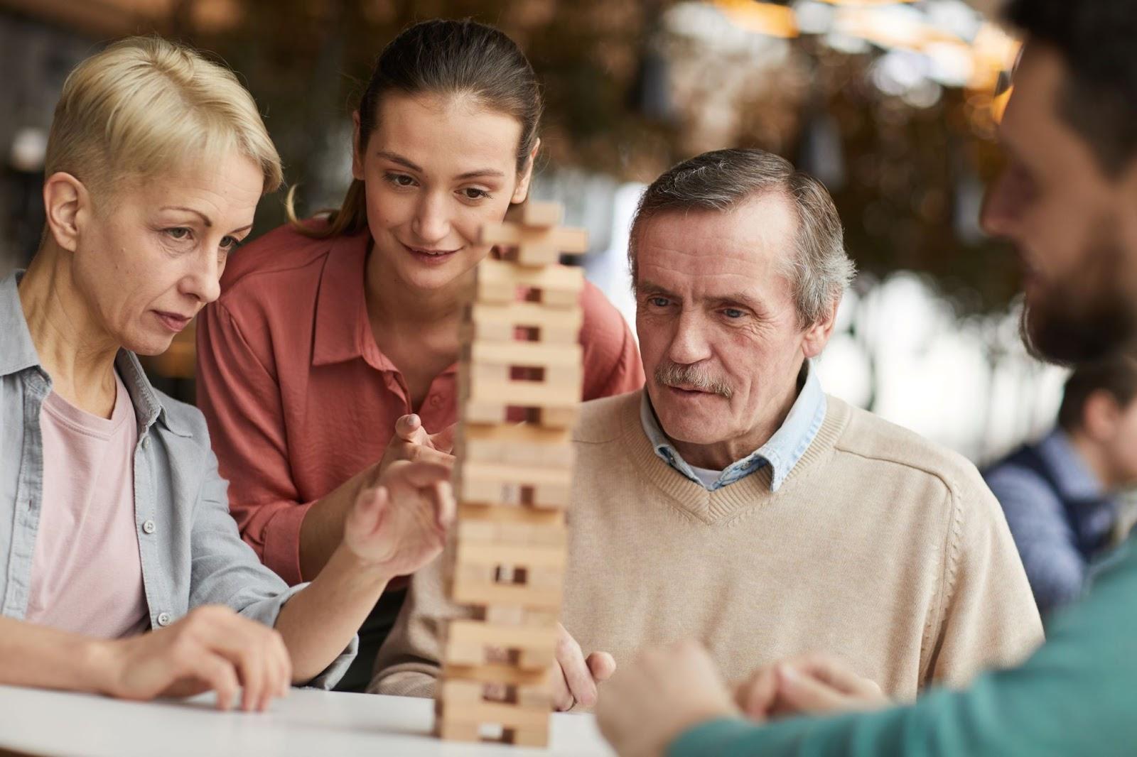 senior-man-and-family-playing-a-game-of-Jenga