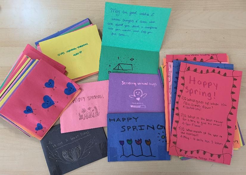 """Colorful greeting cards that say """"Happy spring,"""" containing positive messages and hand-drawn illustrations of flowers"""