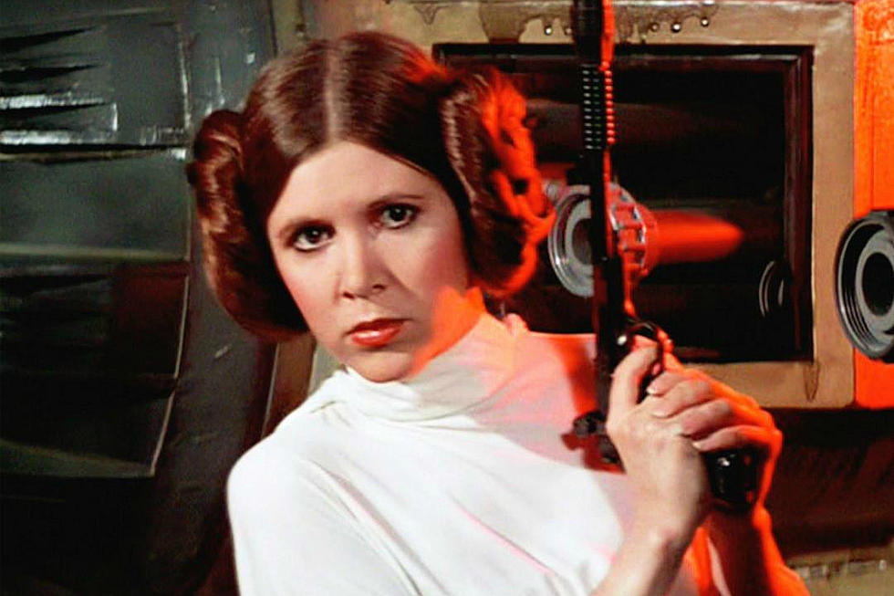Princess Leia, donning her iconic white dress and space buns, sneaks around a corner with her blaster at the ready.
