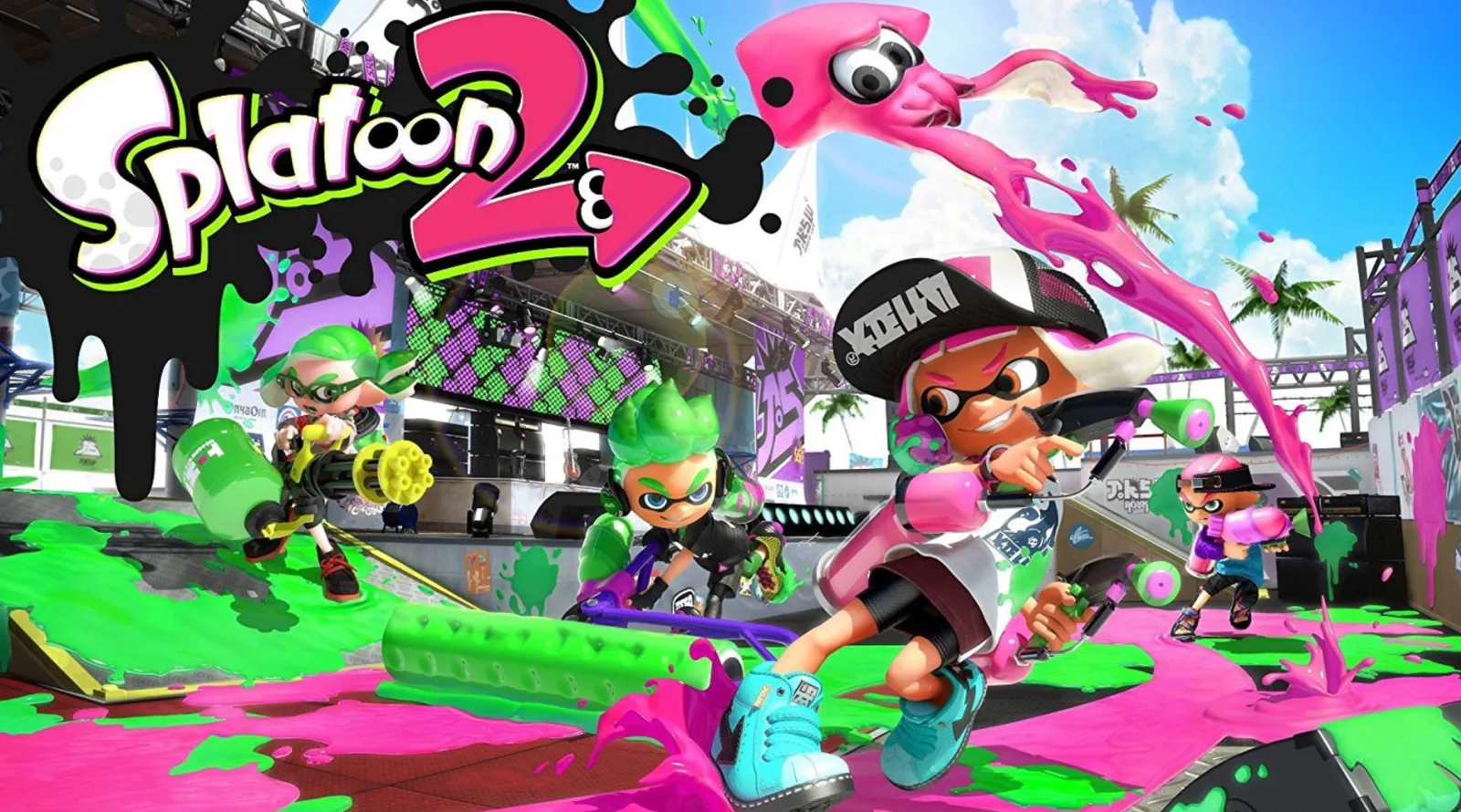 A pink Splatoon Inkling character skids in ink holding an ink gun. Other characters with green ink appear on ramps and ledges in the background. The logo Splatoon 2 is displayed prominently above the characters.