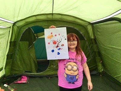 A picture containing indoor, tent, green, girl  Description automatically generated