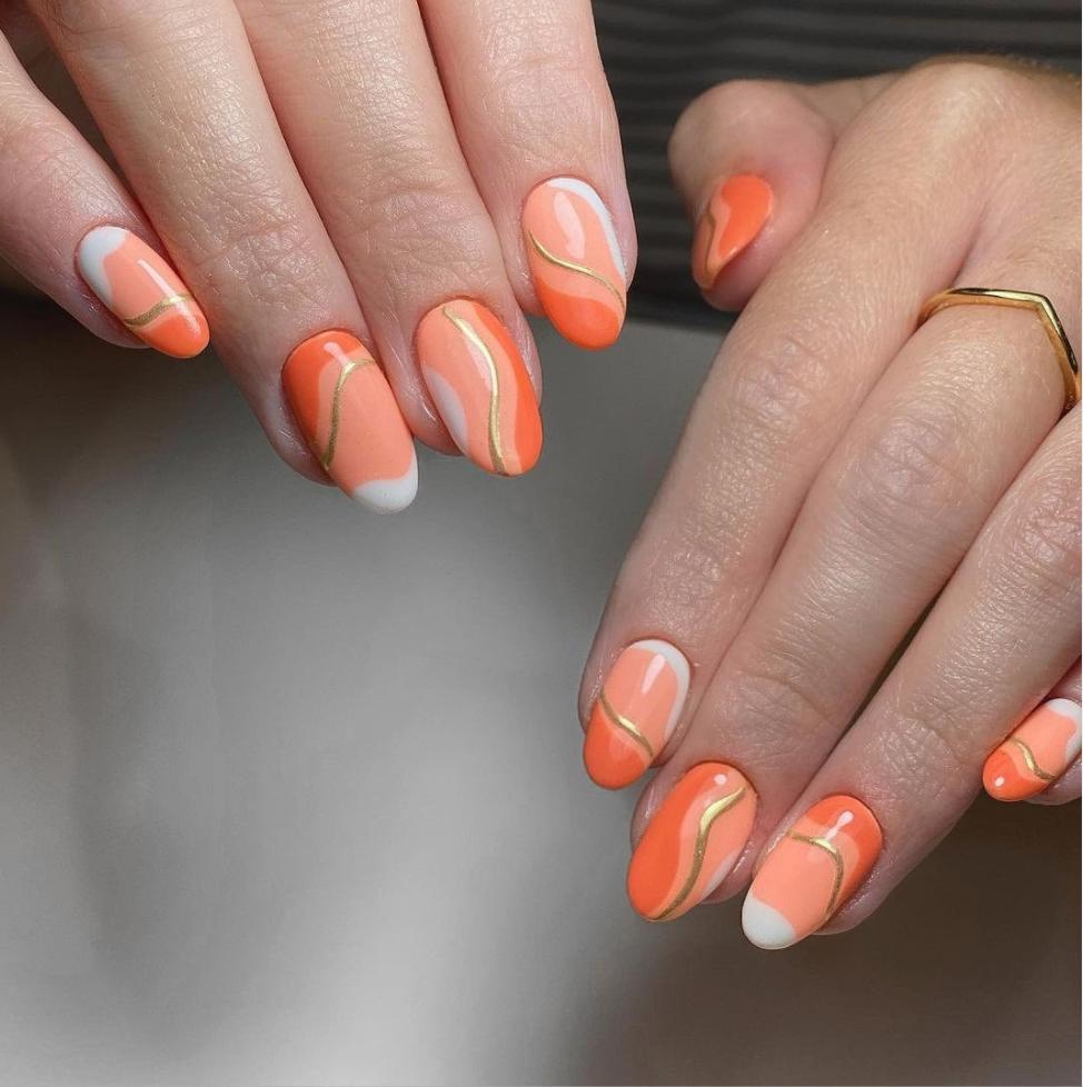 gold and orange nail art
