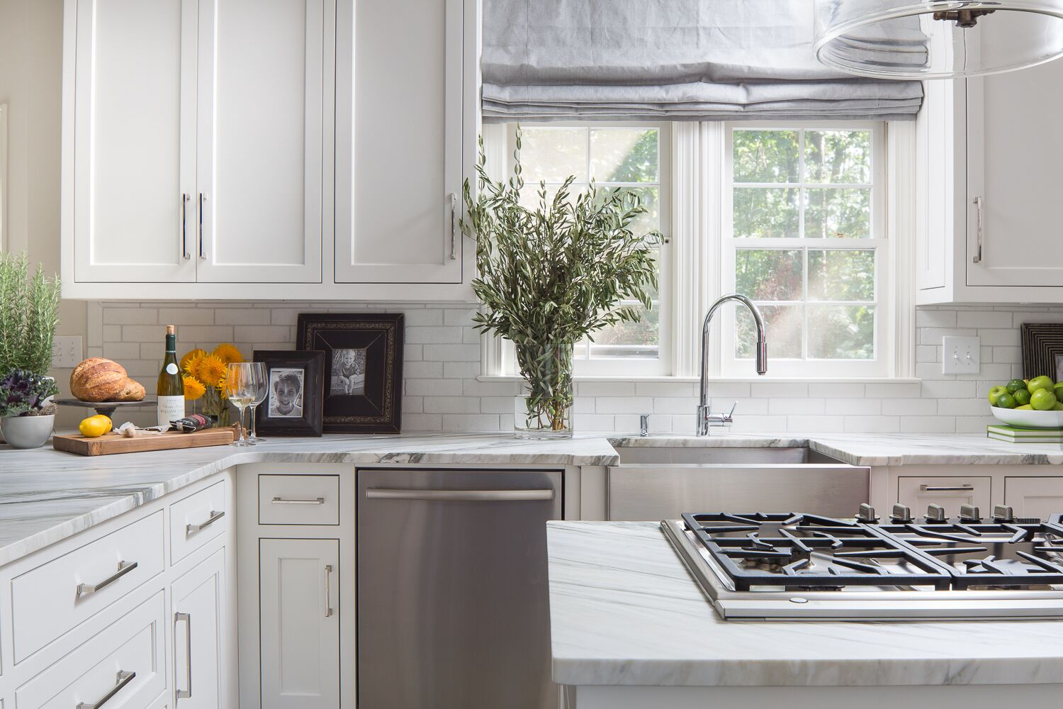 honed marble countertops buckhead white cabinets chrome faucet subway tile tara fust design