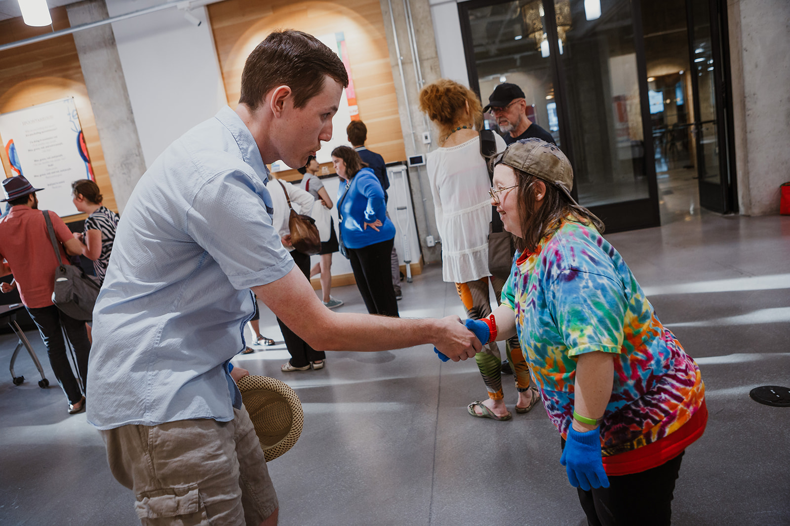 A visitor congratulates Teresa as he shakes her hand. Photo: This Is It Studios.