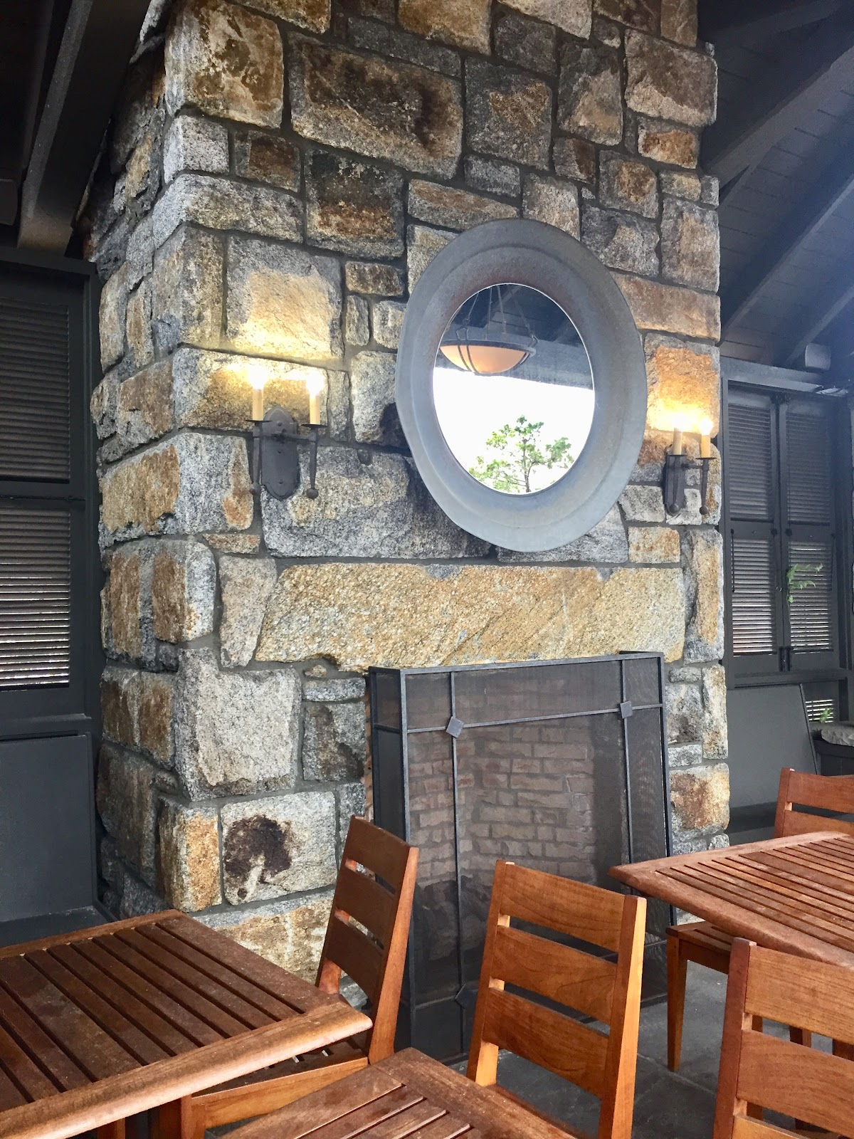 Large Stone Fireplace With Mirror
