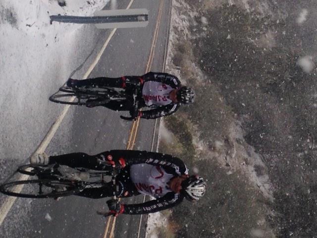 John Johnson and Bill Cappobianco on Onyx Summit riding bikes in the snow