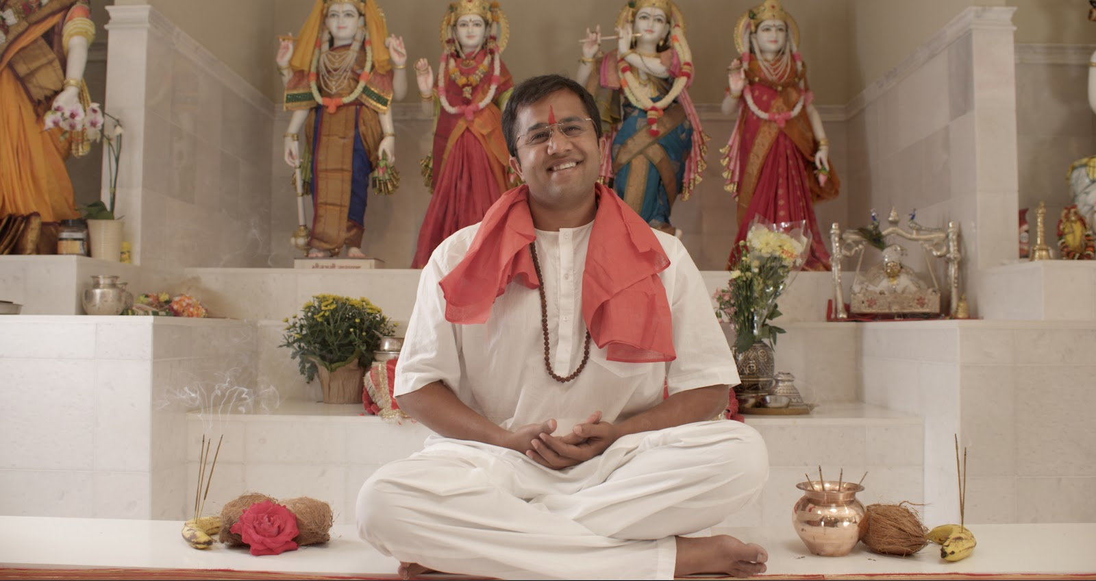 Omi Vaidya at Sunnyvale Hindu Temple in 'For Here or To Go?' directed by Rucha Humnabadkar. (Credit: Many Cups of Chai Films)