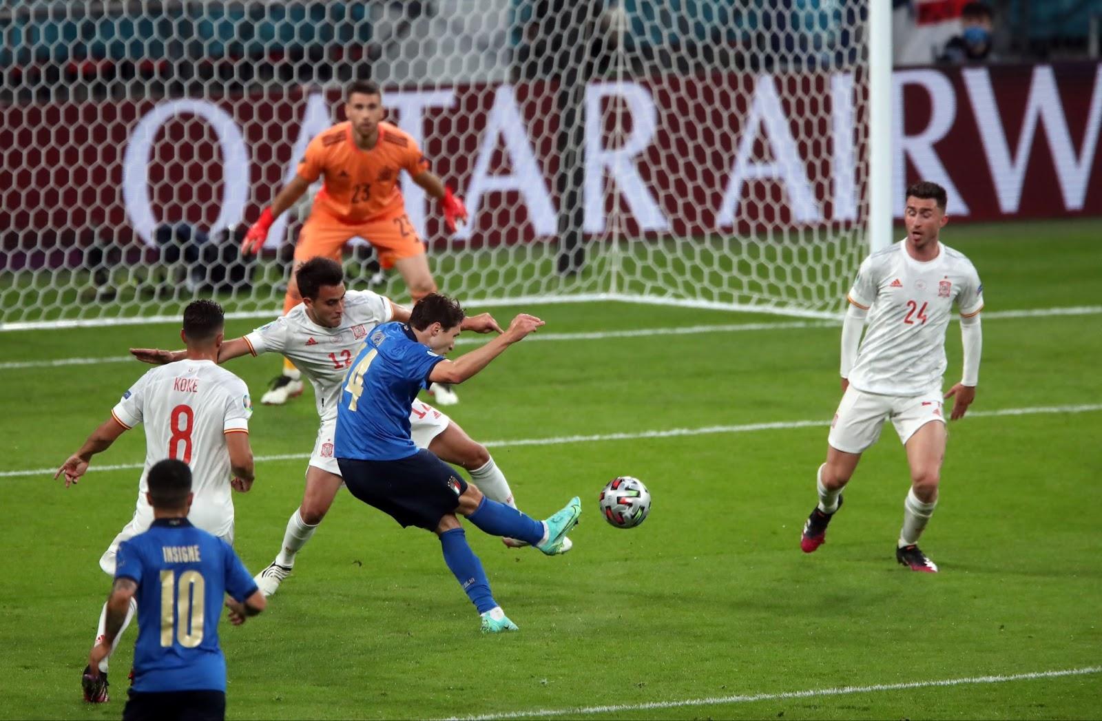 Chiesa curls the ball past Unai Simon