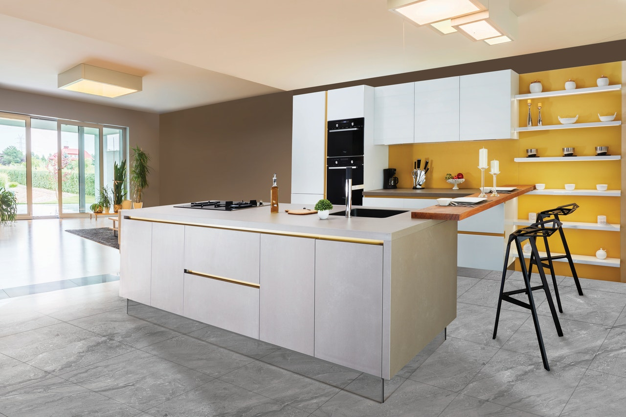 White cabinet designs suit every kitchen and colour scheme; a yellow-walled kitchen with sleek white cabinets and minimalist decor.