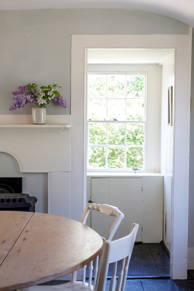 In my own Cape Cod cottage, note how with the absence of curtains, the eye is drawn right through several rooms and out the window beyond. Photograph by Justine Hand for Remodelista.