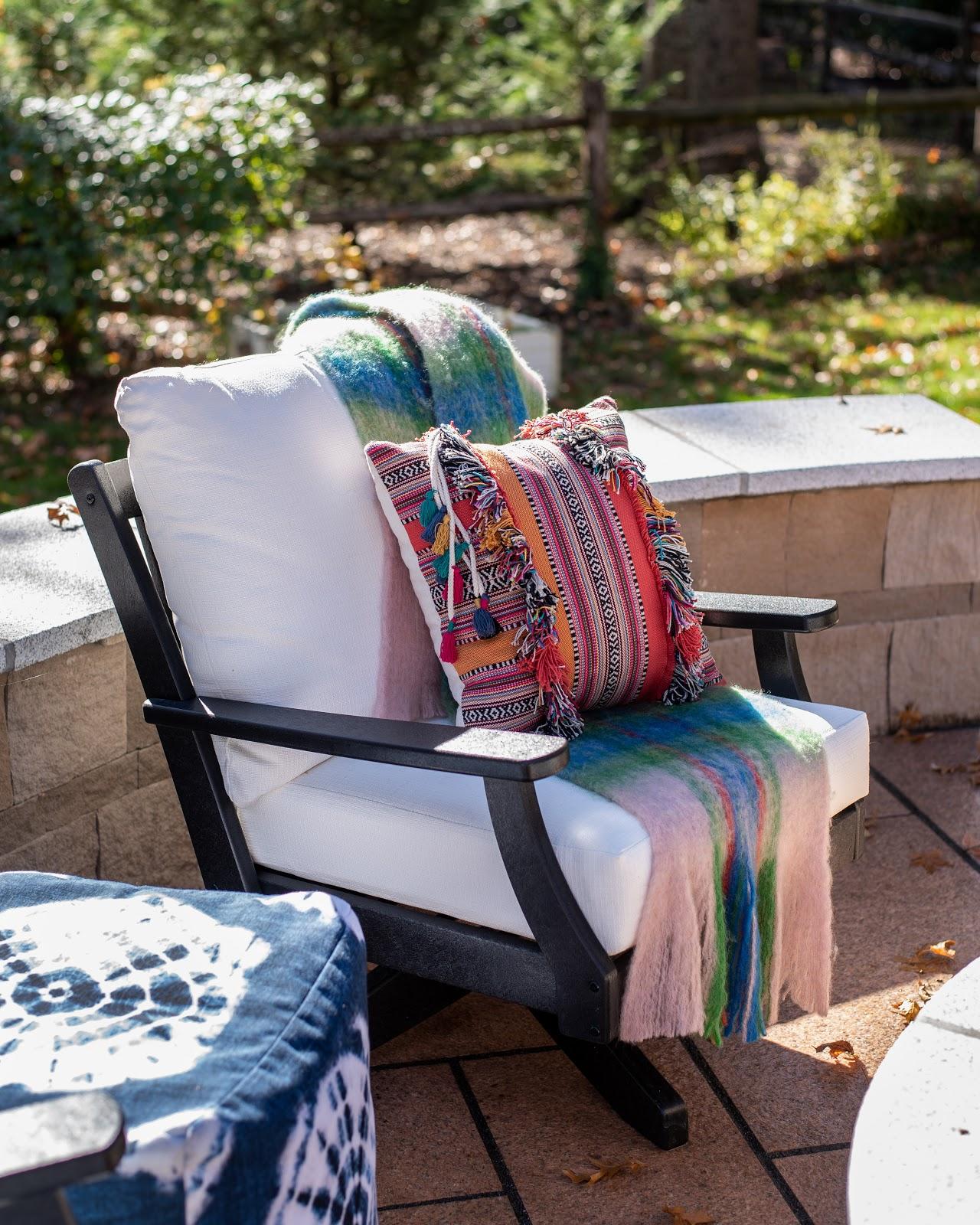 CAROLINA CORAL™granite patio pavers, Polywood chair and SmithHonig pillows outdoors