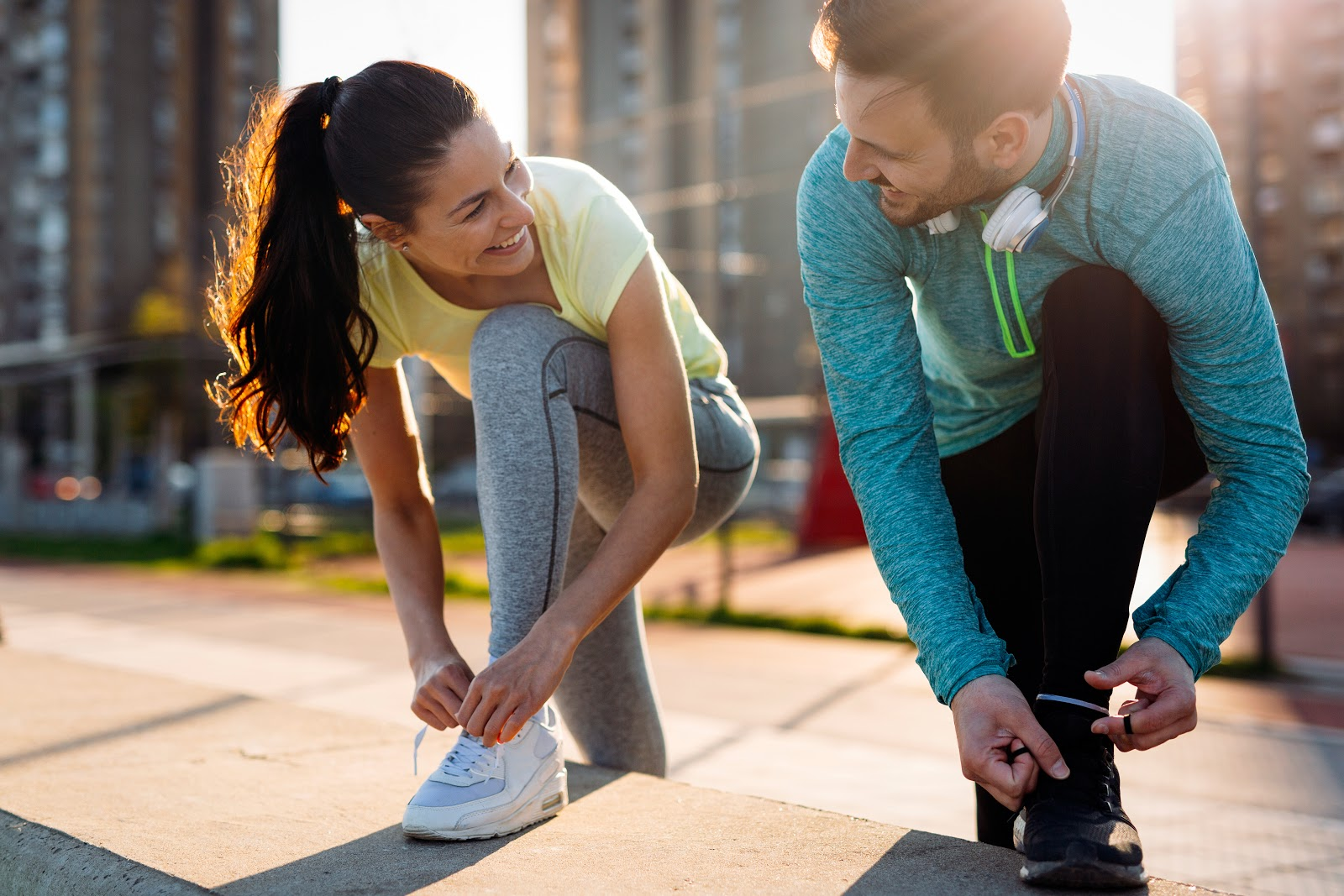 a man and a woman smiling getting ready to exercise