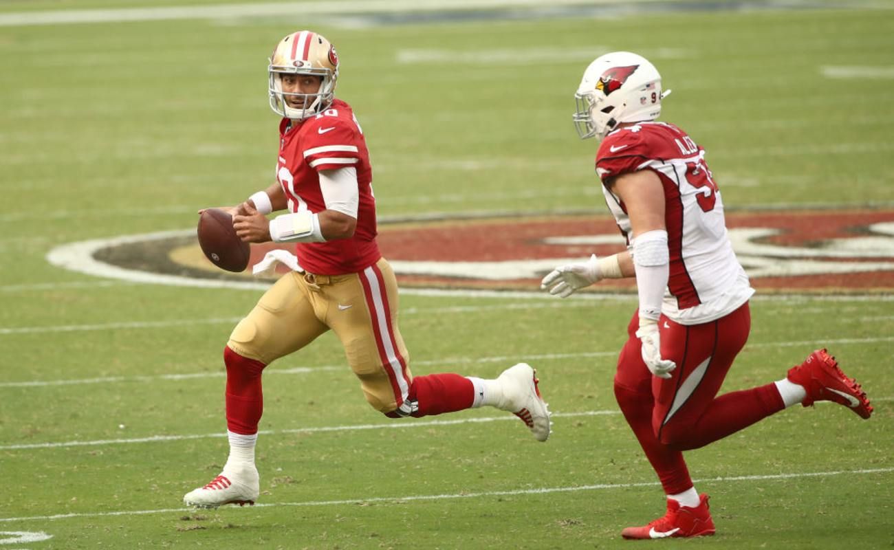 Jimmy Garoppolo #10 of the San Francisco 49ers is chased by Zach Allen #94 of the Arizona Cardinals