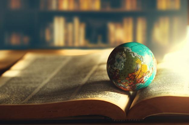 World globe on  book. education school concept Premium Photo