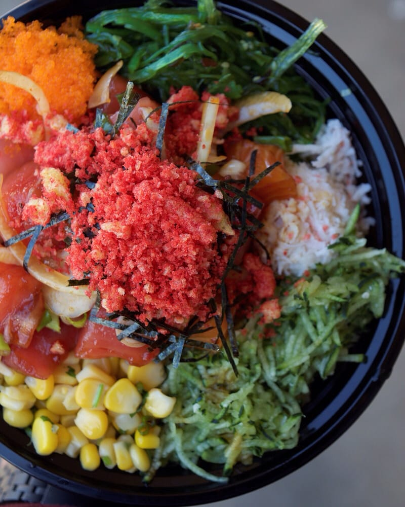 Photo of poke bowl with Hot Cheetos dusted on top.