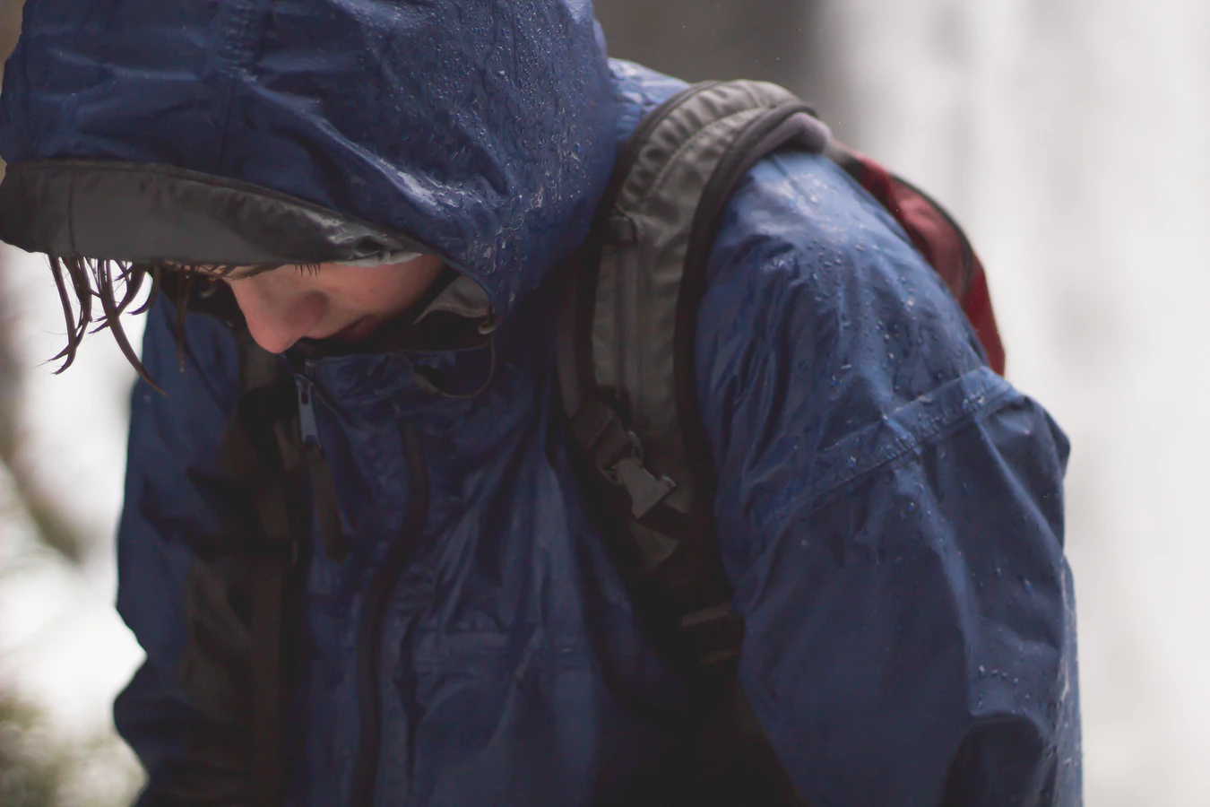 Close-up of a person wearing a raincoat in the rain