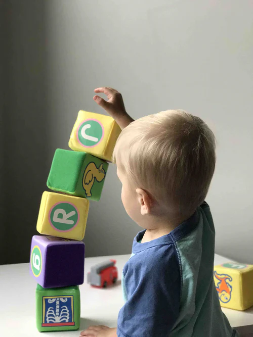 baby playing with cubix