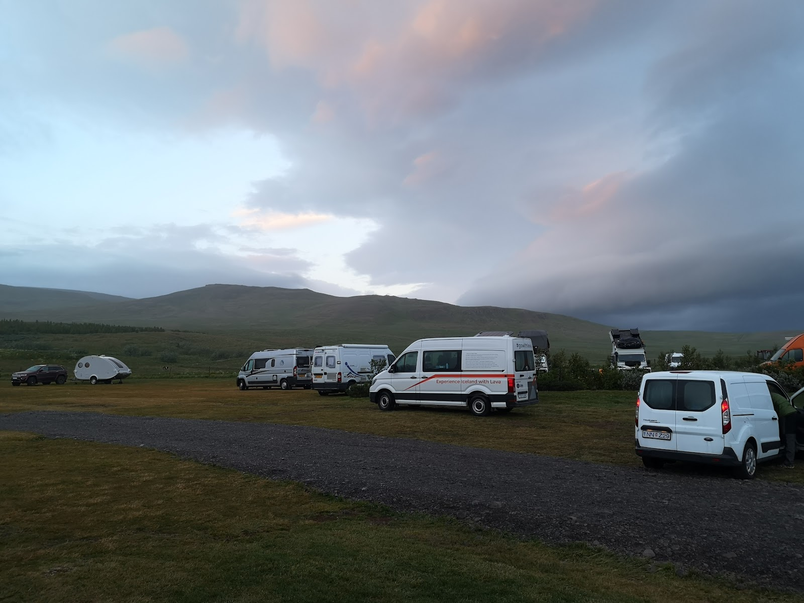 Campervans in Iceland in July at midnight.