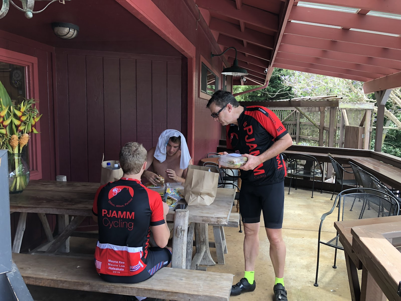 Bike climb Haleakala Volcano - PJAMM cyclists eating lunch Kula Market