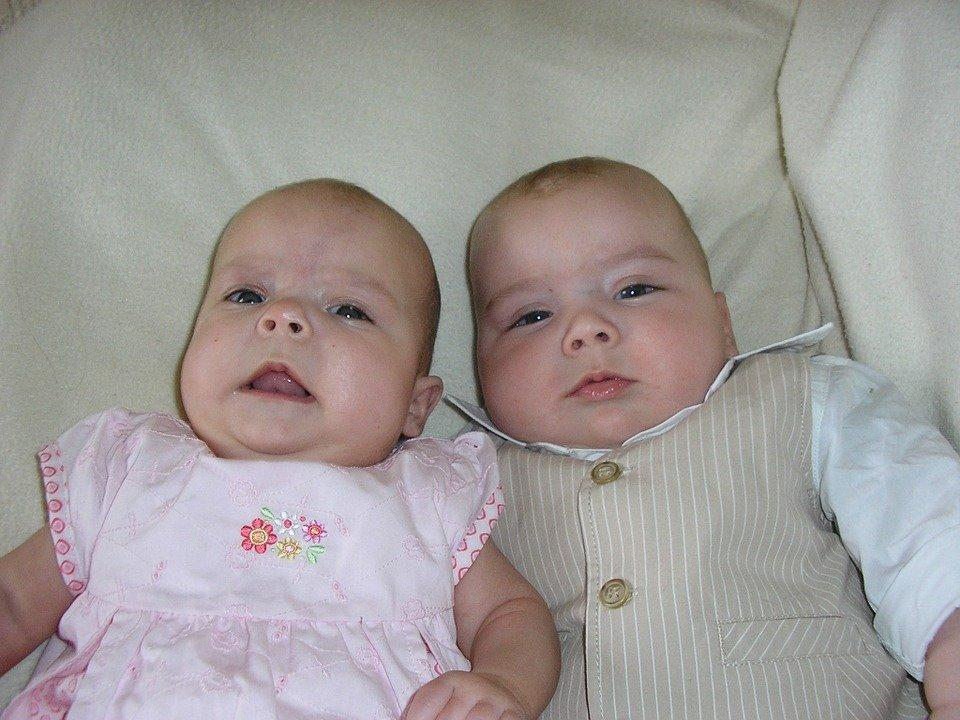 baby twins, one boy and one girl