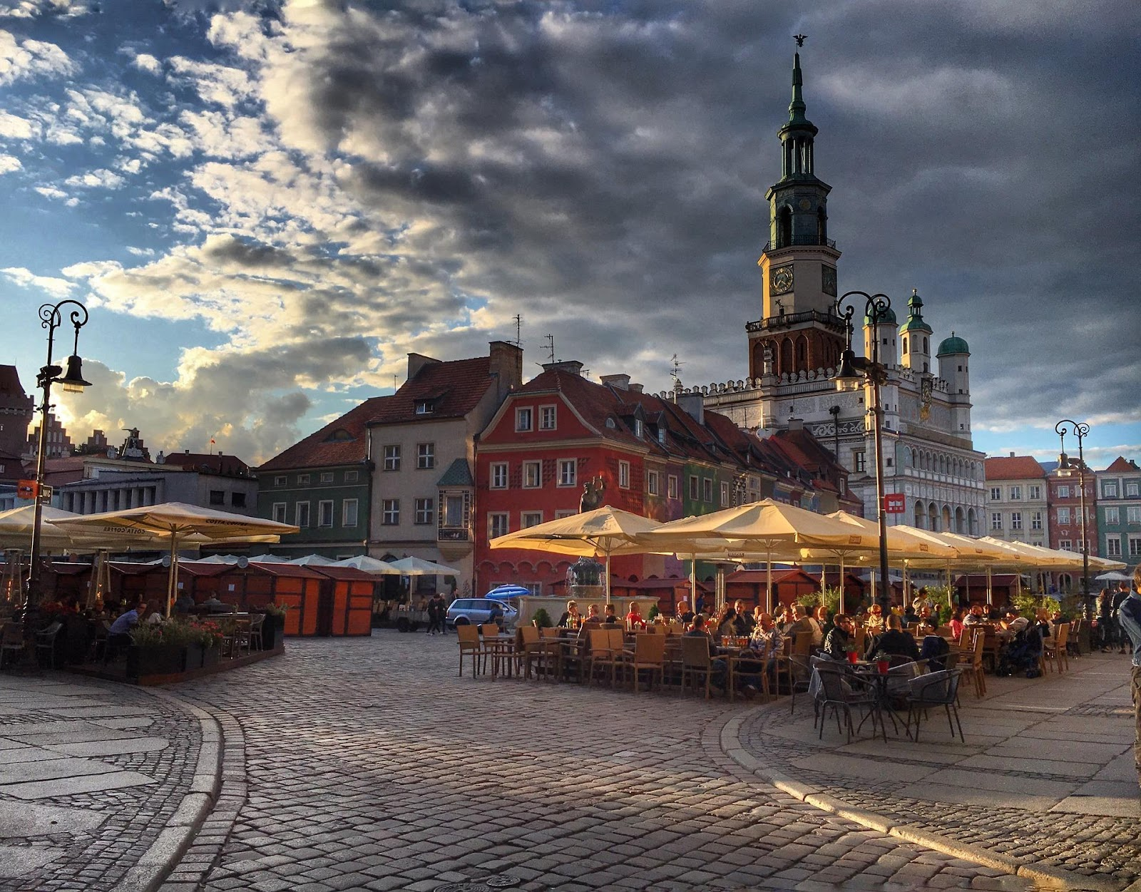 outdoor restaurant in poznan old town square on a cloudy summer day in poland