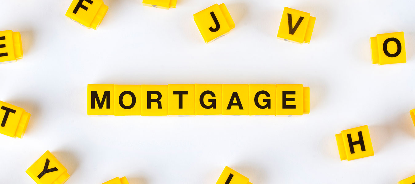 Mortgage written in yellow scrabble pieces
