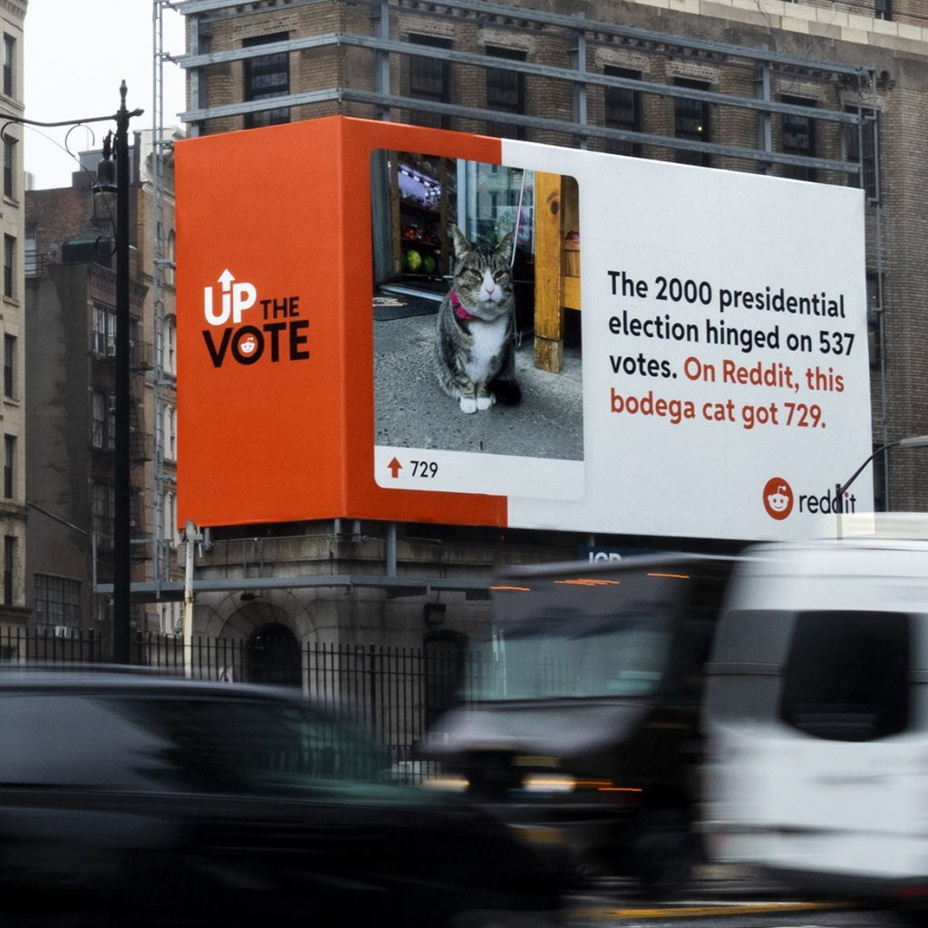 """Reddit's Up the vote billboard with a photo of a cat and the text """"The 2000 presidential election hinged on 537 votes. On Reddit, this bodega cat got 729."""""""