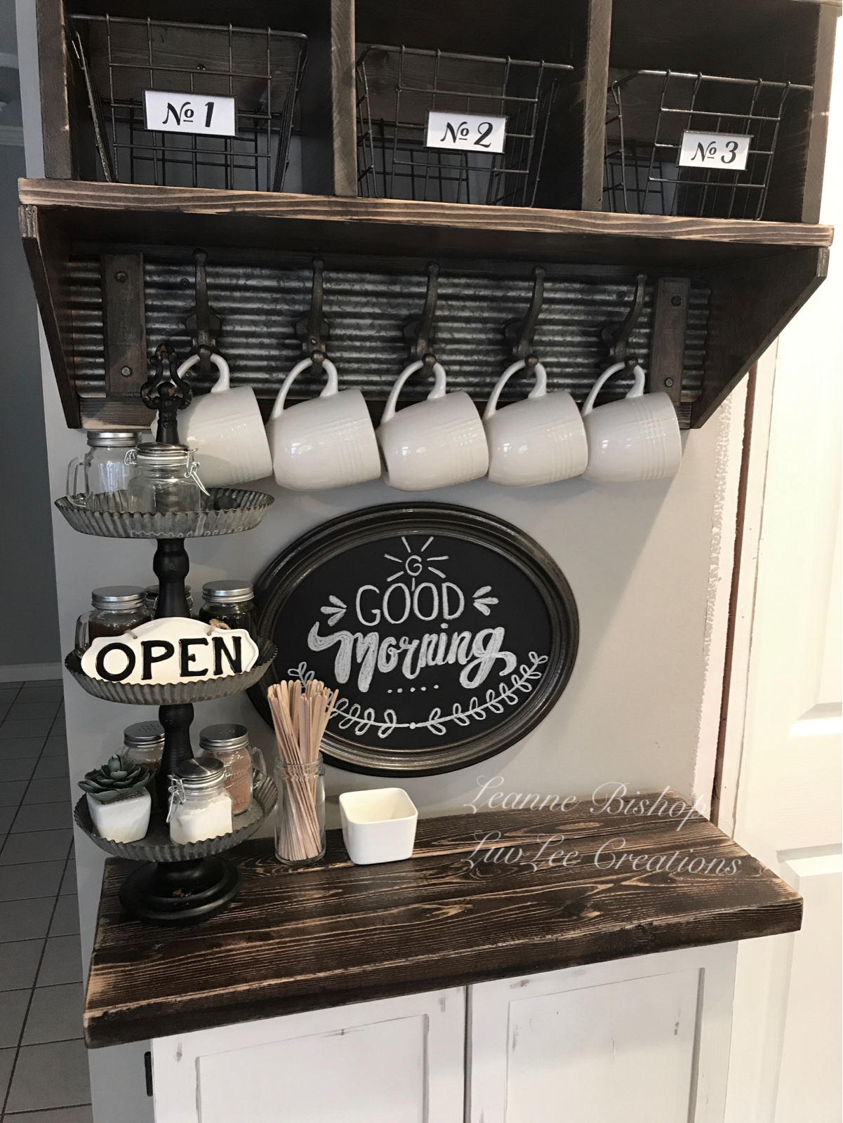 rustic farmhouse coffee bar cabinet with dark wood countertop and farmhouse sign
