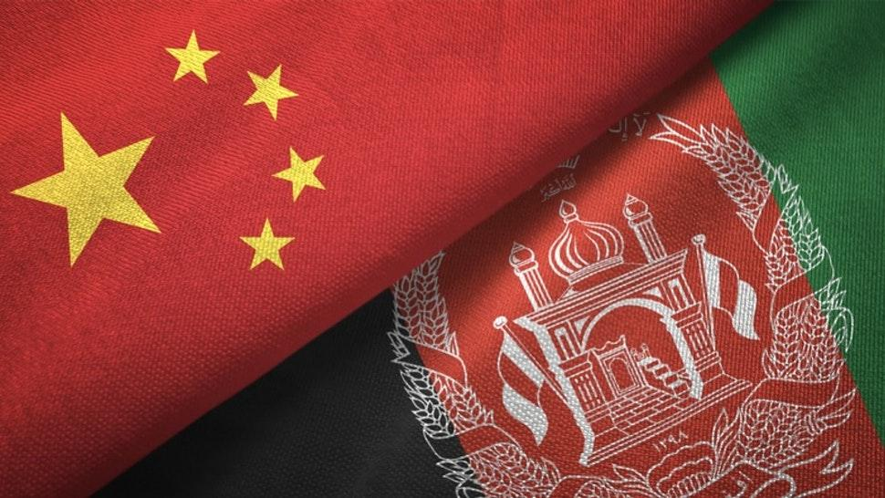 Afghanistan and China two flags together realations textile cloth fabric texture - stock photo Afghanistan and China flag together realtions textile cloth fabric texture Oleksii Liskonih via Getty Images