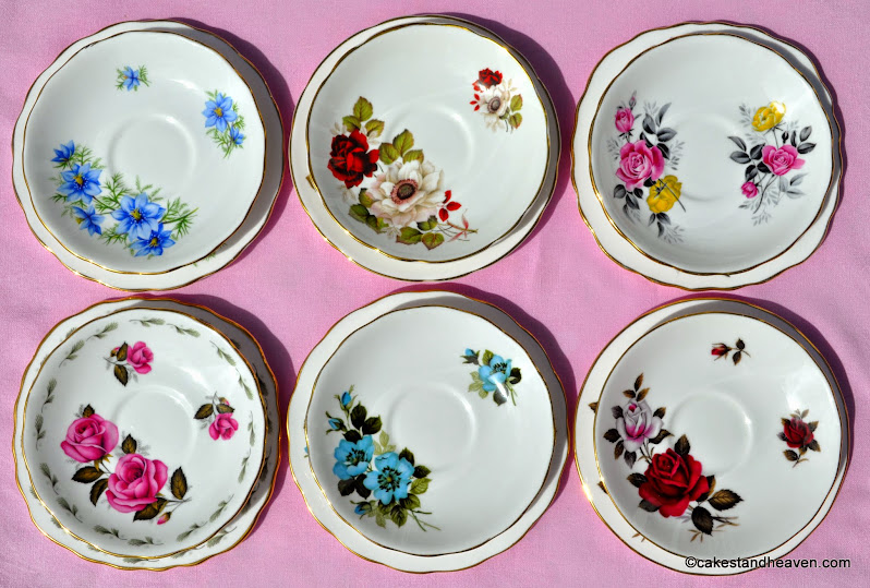 Mismatched floral saucers with beautiful garden flowers