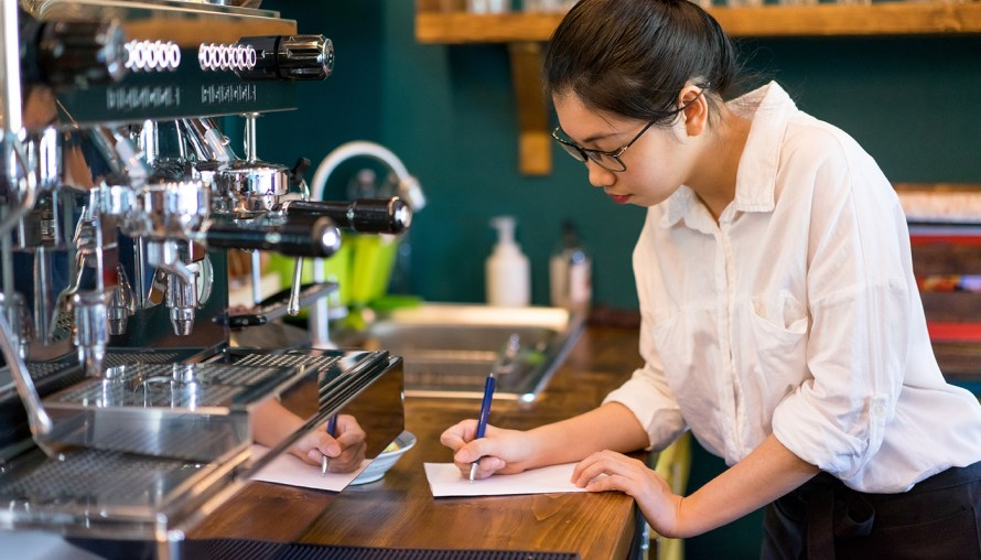 young girl working as a barista