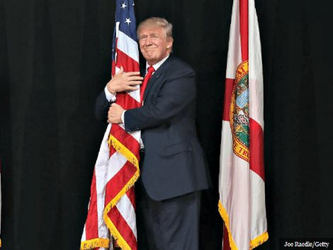 patriot-trump-hugs-flag