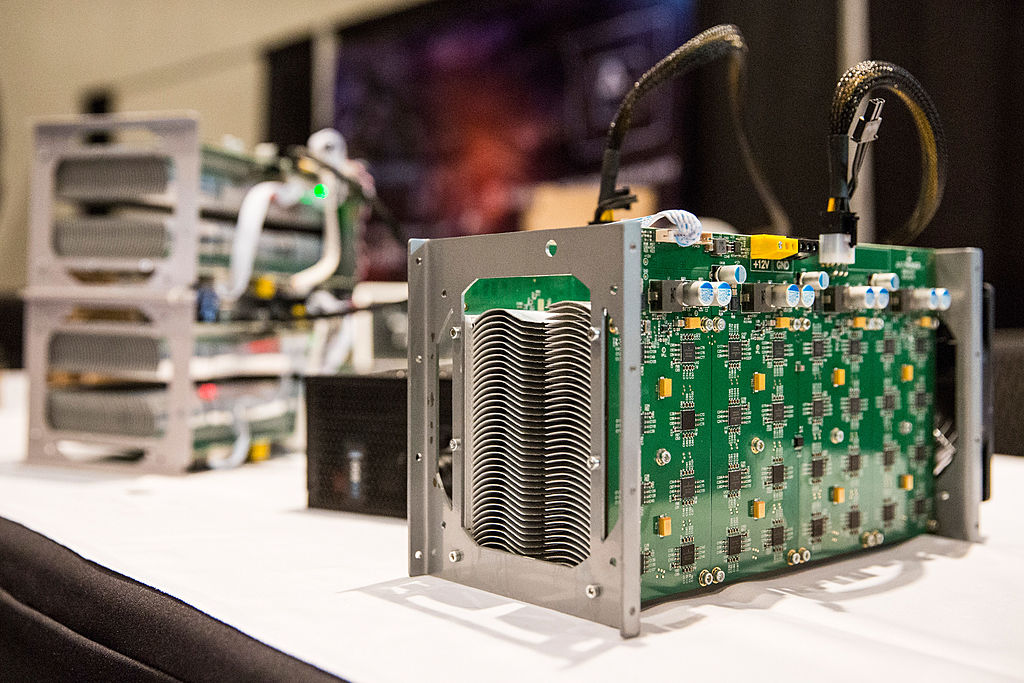 Bitcoin mining hardware is displayed at a Bitcoin conference at the Javits Center April 7, 2014 in New York City. This specialized hardware, which consumes a great deal of semiconductors amid a global supply shortage, does nothing but hash the SHA256 encryption algorithm used to win a reward by the Bitcoin software.