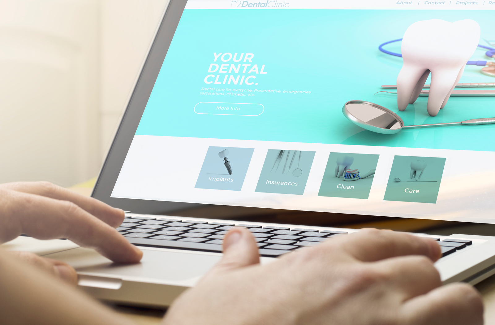 Dental professional working on their website