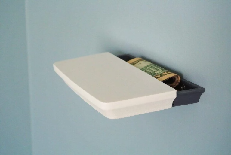 3d printed shelf with secret compartment holding dollar bills