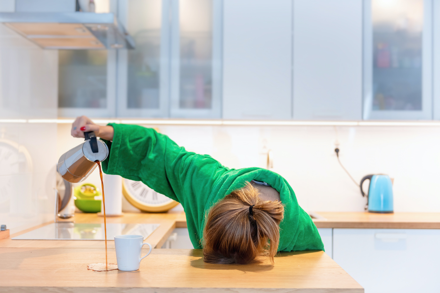 How to heal adrenal fatigue: Woman falling asleep while pouring coffee