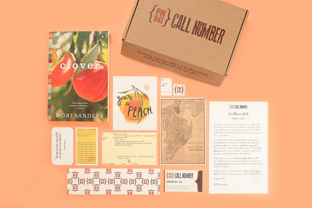 Alt text: contents of a book subscription box from Call Number